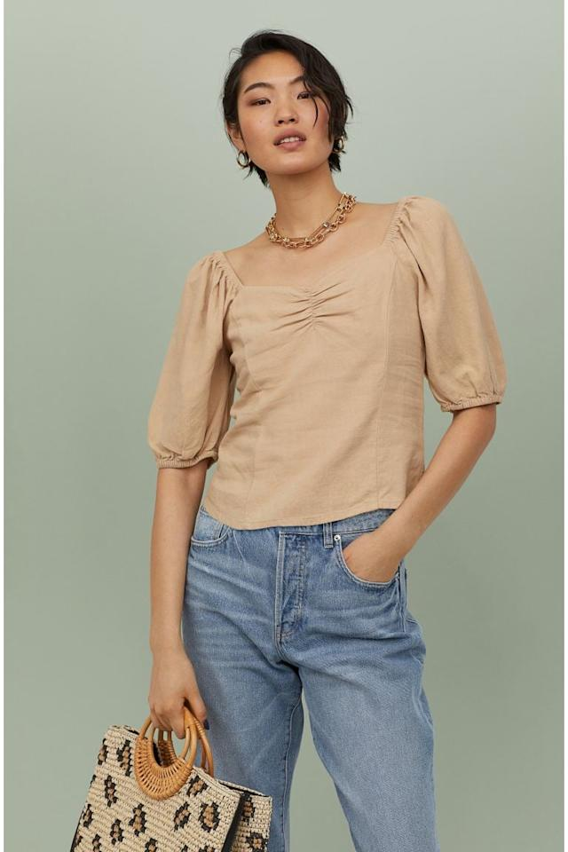 "<p>Style this <a href=""https://www.popsugar.com/buy/HampM-Linen-blend-Top-583869?p_name=H%26amp%3BM%20Linen-blend%20Top&retailer=www2.hm.com&pid=583869&price=25&evar1=fab%3Aus&evar9=47565783&evar98=https%3A%2F%2Fwww.popsugar.com%2Ffashion%2Fphoto-gallery%2F47565783%2Fimage%2F47566050%2FHM-Linen-blend-Top&list1=tops%2Csummer%2Csummer%20fashion%2Cfashion%20shopping&prop13=mobile&pdata=1"" rel=""nofollow"" data-shoppable-link=""1"" target=""_blank"" class=""ga-track"" data-ga-category=""Related"" data-ga-label=""https://www2.hm.com/en_us/productpage.0840607009.html"" data-ga-action=""In-Line Links"">H&amp;M Linen-blend Top</a> ($25) with jeans.</p>"