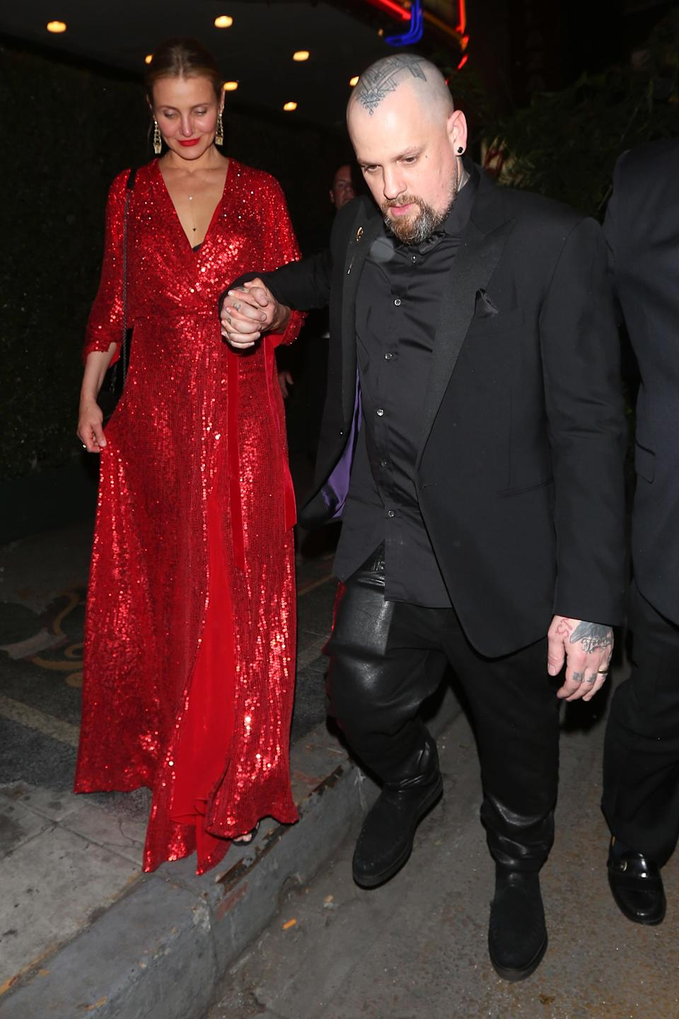 The newly retired Cameron Diaz and husband Benji Madden arriving for Gwyneth Paltrow and Brad Falchuk's engagement party on April 14. (Photo: Splash News)