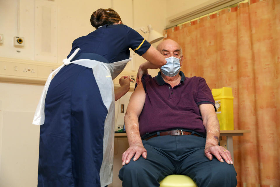 FILE - In this Monday, Jan. 4, 2021 file photo, 82-year-old Brian Pinker receives the Oxford University/AstraZeneca COVID-19 vaccine from nurse Sam Foster at the Churchill Hospital in Oxford, England. Pinker, a retired maintenance manager received the first injection of the new vaccine developed by between Oxford University and drug giant AstraZeneca. Britain races to vaccinate more than 15 million people by mid-February, and in an effort to ensure vaccines get to the right places at the right times, along with the syringes, alcohol swabs and protective equipment needed to administer them, the government has called in the army. (Steve Parsons/Pool Photo via AP, File)