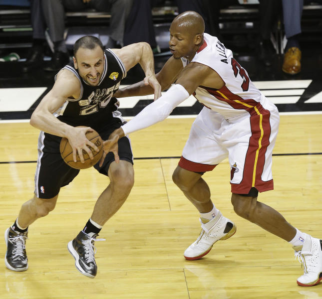 San Antonio Spurs shooting guard Manu Ginobili (20) of Argentina, and Miami Heat shooting guard Ray Allen (34) work during the first half of Game 2 of the NBA Finals basketball game, Sunday, June 9, 2013 in Miami. (AP Photo/Wilfredo Lee)
