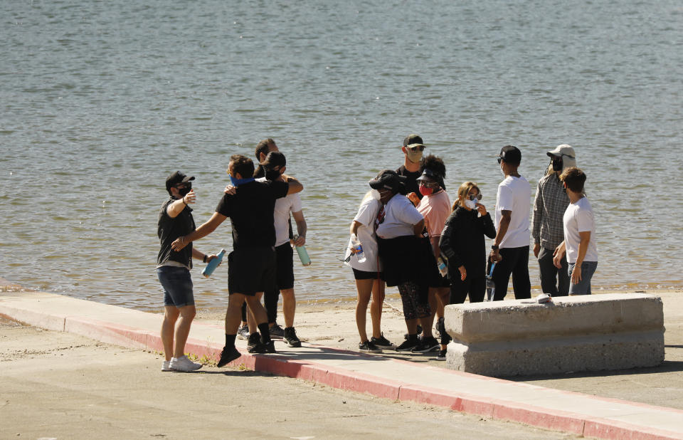 Glee cast and Naya Rivera's friends comfort each other on Lake Piru