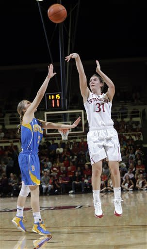 Stanford 's Toni Kokenis (31) shoots over UCLA 's Kari Korver (2) during the first half of an NCAA college basketball game in Stanford, Calif., Friday, Jan. 18, 2013. (AP Photo/Marcio Jose Sanchez)