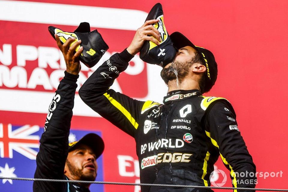 """Race Winner Lewis Hamilton, Mercedes-AMG F1 and Daniel Ricciardo, Renault F1 celebrate on the podium with a shoey<span class=""""copyright"""">Andy Hone / Motorsport Images</span>"""