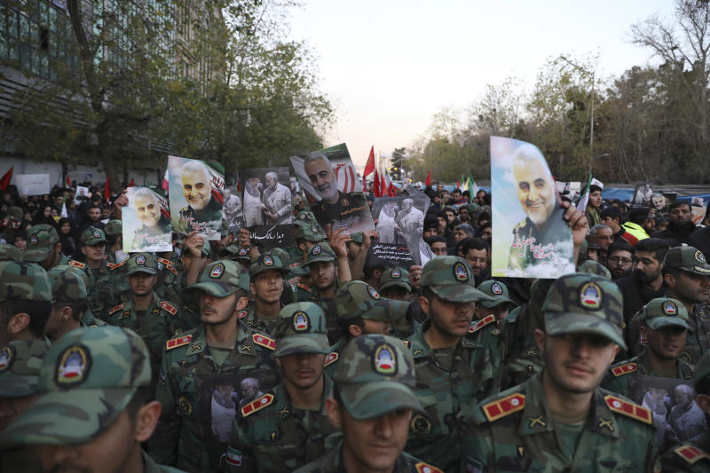 Army cadets attend a funeral ceremony for Iranian Gen. Qassem Soleimani, shown in posters, and his comrades, who were killed in Iraq in a U.S. drone strike on Friday, at the Enqelab-e-Eslami (Islamic Revolution) square in Tehran, Iran, Monday, Jan. 6, 2020. (AP Photo/Ebrahim Noroozi)