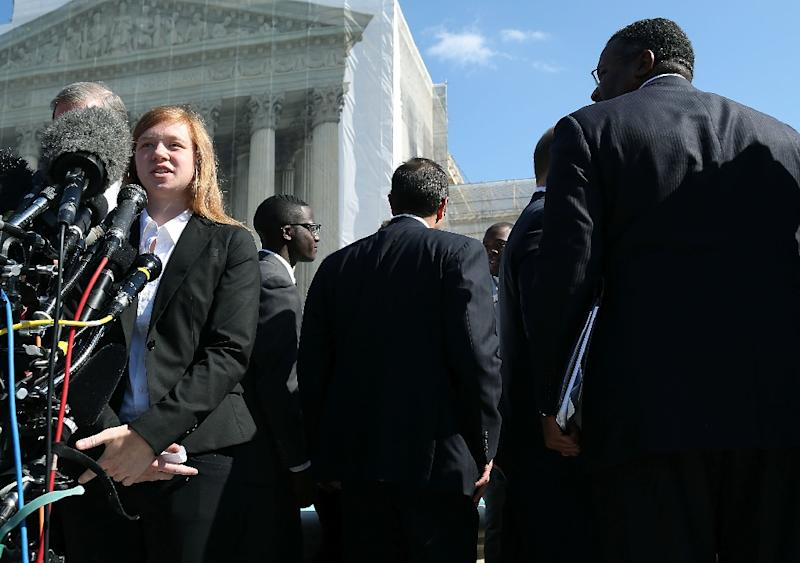 Plaintiff Abigail Noel Fisher (L) speaks to the media after the US Supreme Court Supreme heard arguments in her case on October 10, 2012 in Washington, DC