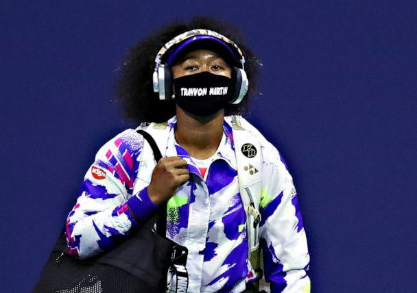 PHOTO: Naomi Osaka of Japan walks out wearing a mask with the name of Trayvon Martin printed on it before her Women's Singles fourth round match against Anett Kontaveit of Estonia on Day Seven of the US Open, Sept. 6, 2020, in Queens, New York. (Matthew Stockman/Getty Images)
