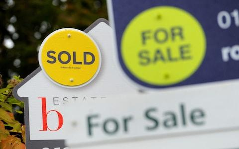 Sold and For Sale signs. - Credit: Andrew Matthews/PA