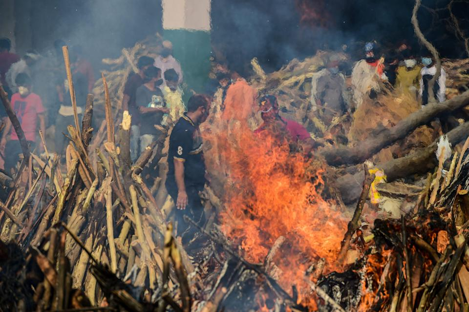 Mass cremation of people who died of coronavirus at a cremation ground at Ghazipur, in New Delhi, Friday, 30 April 2021.