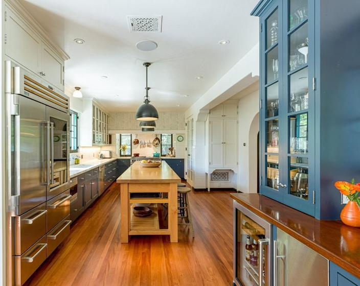 Unlike the dark dining area, Leo's new kitchen is brimming with natural light.