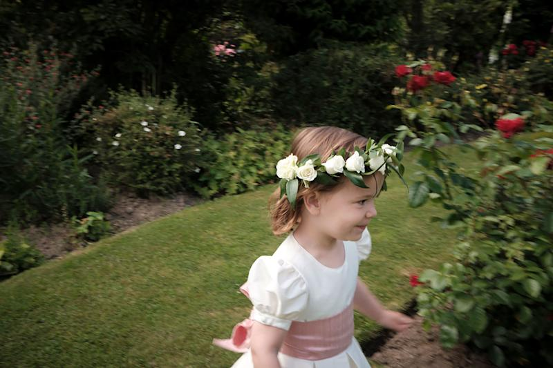 One of our flower girls, Leonore, playing among the roses.