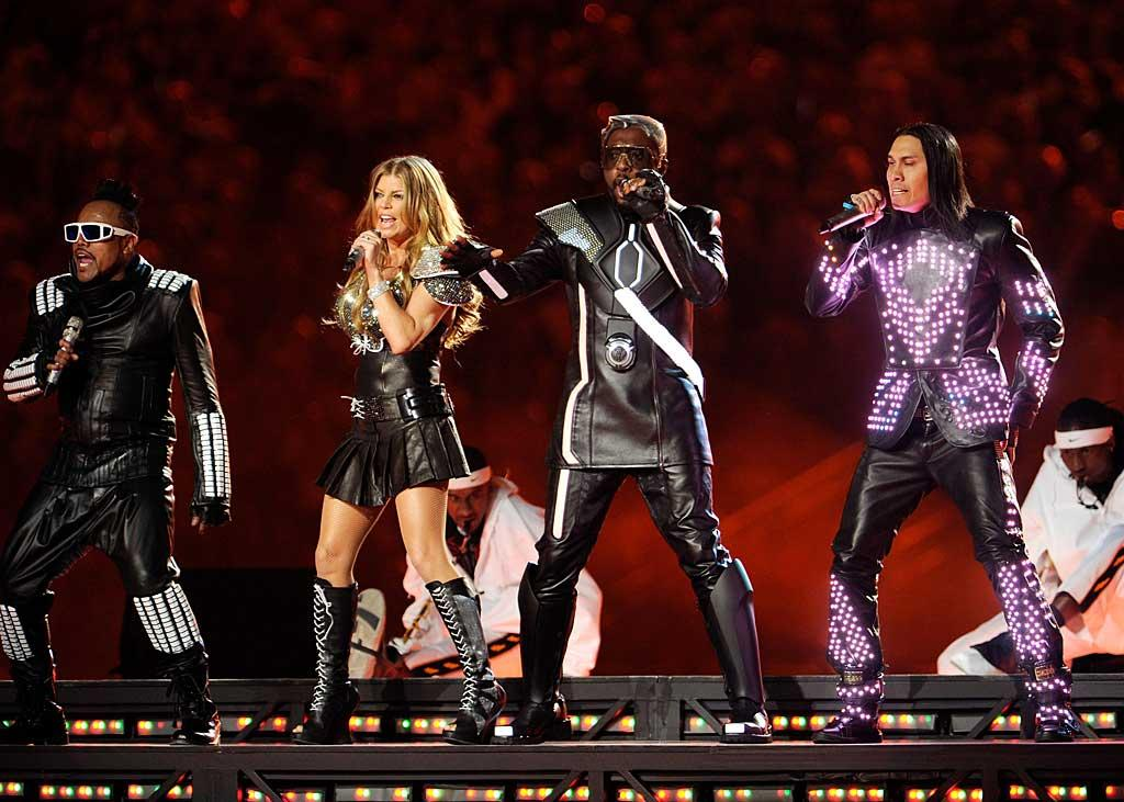 "At halftime, the Black Eyed Peas (apl.de.ap, Fergie, will.i.am, and Taboo) lit up the field, literally, in ""Tron""-inspired getups. While they definitely know how to put on a show, unfortunately their performance was plagued by technical difficulties and they didn't exactly sound their best. Kevin Mazur/<a href=""http://www.wireimage.com"" target=""new"">WireImage.com</a> - February 6, 2011"