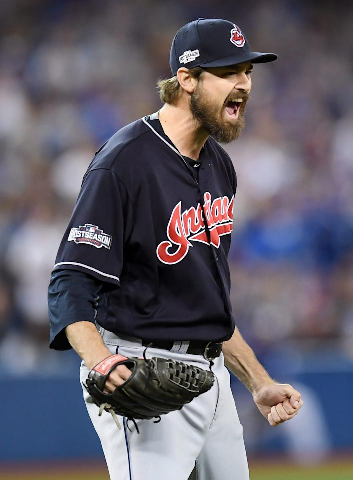 Cleveland Indians relief pitcher Andrew Miller celebrates after Toronto Blue Jays' Josh Donaldson hit into an inning-ending double play during sixth inning during Game 5 of baseball's American League Championship Series in Toronto, Wednesday, Oct. 19, 2016. (Frank Gunn/The Canadian Press via AP)