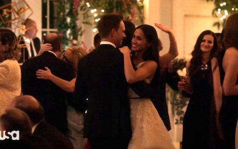 Meghan Markle and Patrick J Adams in Suits - Credit: NIPI