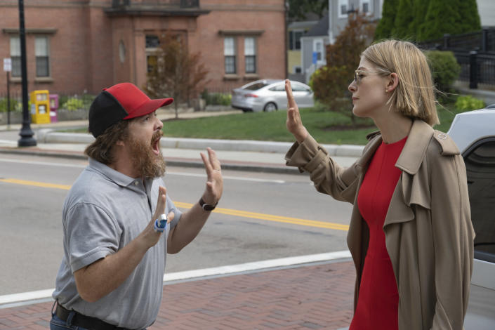 """This image released by Netflix shows Macon Blair, left, and Rosamund Pike in a scene from """"I Care A Lot."""" (Seacia Pavao/Netflix via AP)"""