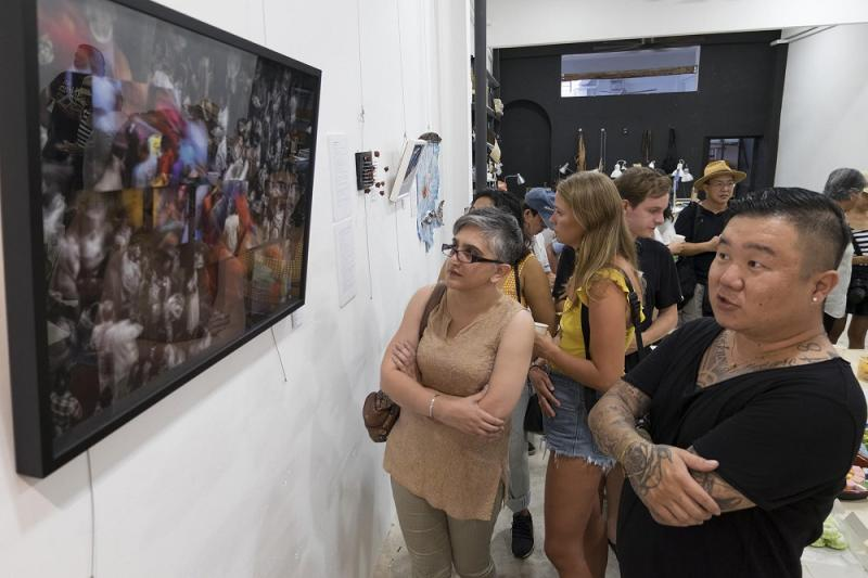 "People admiring the artworks on display at the 8"" x 6 "" project group exhibition at Project 26 Lorong Carnavon. — Picture by Steven Ooi K.E. and Sayuti Zainudin"