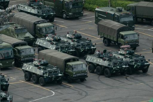 Beijing has massed security forces in Shenzhen, bordering Hong Kong, in a show of force