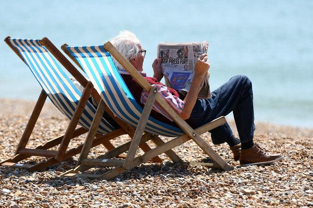 People enjoy the sunshine on the beach in Brighton, East Sussex, this month.