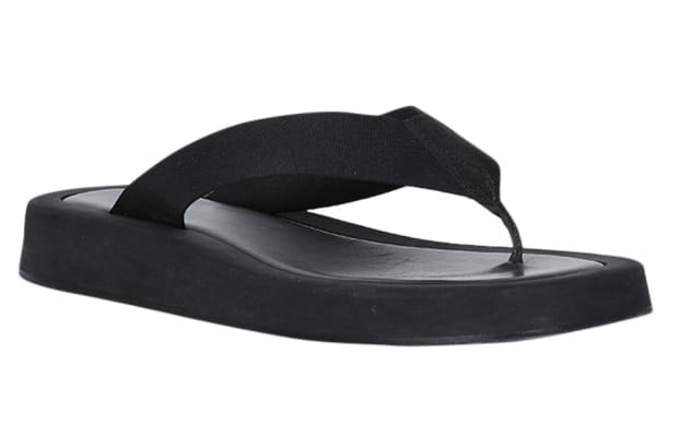 """<p>The Row Ginza Sandal, $690, <a href=""""https://rstyle.me/+u67sC6GitRzMnoT1h0i8XA"""" rel=""""nofollow noopener"""" target=""""_blank"""" data-ylk=""""slk:available here"""" class=""""link rapid-noclick-resp"""">available here</a>. </p>"""