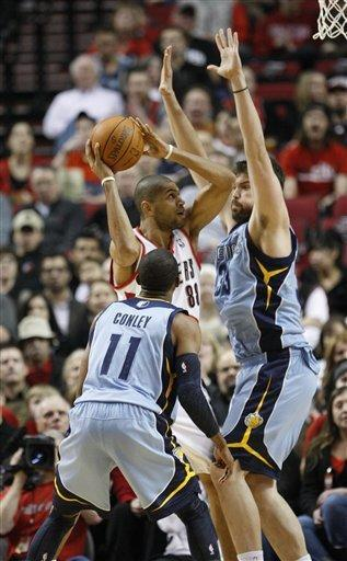 Portland Trail Blazers' Nicolas Batum (88) looks toward the basket as Memphis Grizzlies' Mike Conley (11) and Marc Gasol (33) defend during the first quarter of an NBA basketball game Thursday, March 22, 2012, in Portland, Ore. (AP Photo/Rick Bowmer)