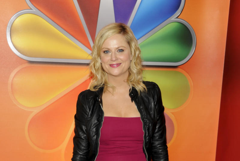 """FILE In this May 14, 2012 file photo, actress Amy Poehler from """"Parks and Recreation"""" arrives for the NBC network upfront presentation at Radio City Music Hall, in New York. 2012 Emmy nominee Amy Poehler jokingly says that baby aspirin and a small children's pool of sangria helps to combat award show nerves for the veteran actress. (AP Photo/Evan Agostini, File)"""