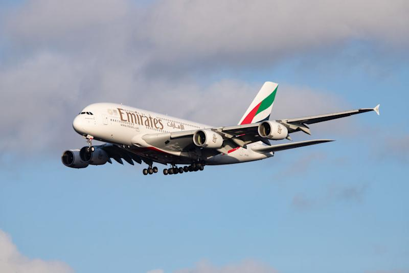 Emirates Airbus A380-800 airplane with registration A6-EEE landing at Amsterdam Schiphol AMS EHAM International Airport in a blue sky with clouds day. Emirates EK or UAE is the large airline in the Middle East and larger Airbus A380 double decker aircraft operator. Emirates connects Amsterdam with DXB OMDB Dubai International Airport daily as it is their hub. The airline is owned by the government of Dubai, United Arab Emirates. Source: Getty