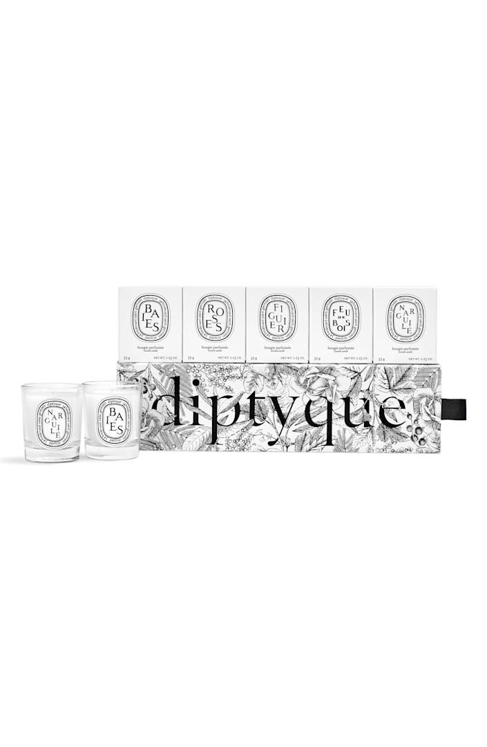 """Try them all, or infuse your home with your existing Diptyque favorites. This set includes their Baies, Feu de Bois, Figuier, Narguilé, and Roses scents. $75, Nordstrom. <a href=""""https://www.nordstrom.com/s/diptyque-set-of-5-travel-size-limited-edition-scented-candles-75-value/5267363"""" rel=""""nofollow noopener"""" target=""""_blank"""" data-ylk=""""slk:Get it now!"""" class=""""link rapid-noclick-resp"""">Get it now!</a>"""