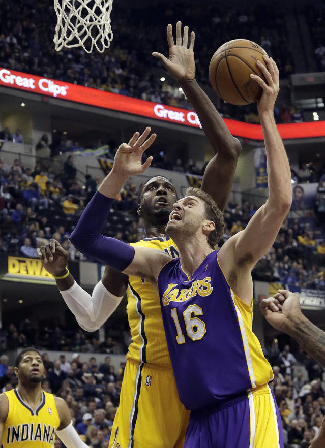 Los Angeles Lakers center Pau Gasol, of Spain, right, shoots in front of Indiana Pacers center Roy Hibbert during the first half of an NBA basketball game in Indianapolis, Tuesday, Feb. 25, 2014. (AP Photo/AJ Mast)