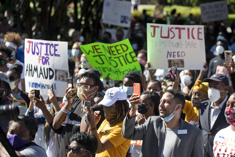 "REMOVES ""UNARMED"" AND ADDS THAT AUTHORITIES HAVE NOT CONFIRMED THAT ARBERY WAS EITHER ARMED OR UNARMED - People react during a rally to protest the shooting of Ahmaud Arbery, Friday, May 8, 2020, in Brunswick Ga. Two men have been charged with murder in the February shooting death of Arbery, a black man in his mid-20s, whom they had pursued in a truck after spotting him running in their neighborhood. (AP Photo/John Bazemore)"