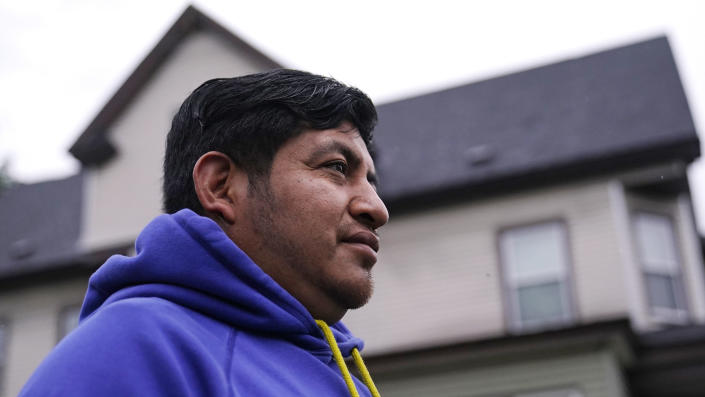 Lucio Perez poses outside his home, where he has lived with his family since March, Thursday, July 8, 2021, in Springfield, Mass. Just a few months ago, Perez moved out of a western Massachusetts church he'd lived in for more than three years to avoid deportation. Immigration authorities in March granted the 37-year-old Guatemalan national a temporary stay in his deportation while he argued to have his immigration case reconsidered. (AP Photo/Charles Krupa)