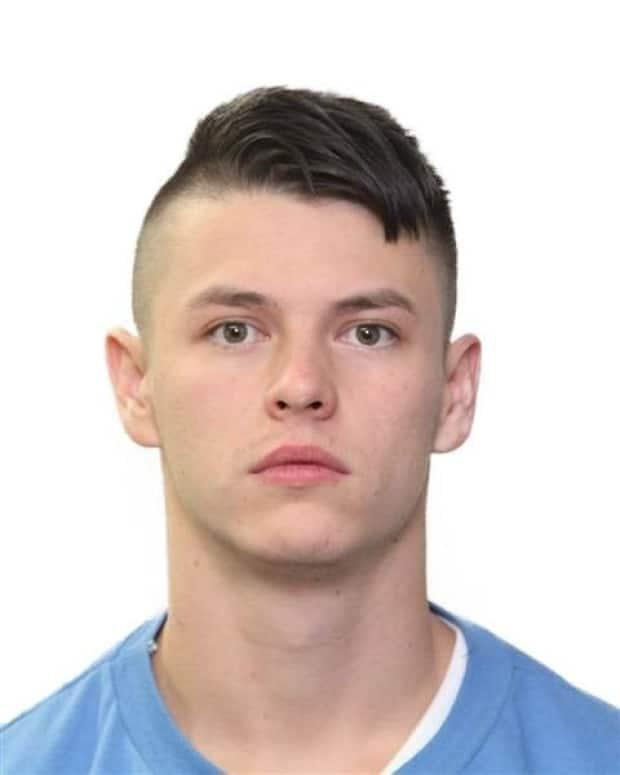 Cody John Landry, 27, is wanted on warrants for assault causing bodily harm in connection with an attack on an 18-year-old who was walking with his father on a downtown river pathway. (Calgary Police Service - image credit)