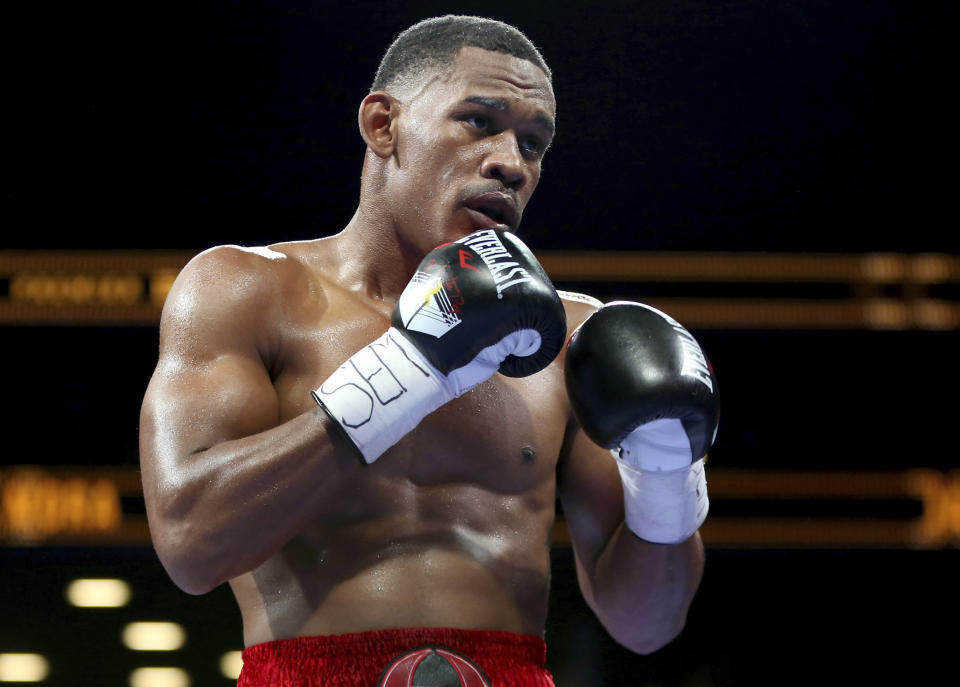 FILE - In this Saturday, Aug. 1, 2015, file photo, Danny Jacobs fights Sergio Mora during their WBA Middleweight title boxing match at the Barclays Center in New York. Canelo Alvarez will return to the ring and to the middleweight division on May 4, 2019, to fight Jacobs. (AP Photo/Gregory Payan, File)