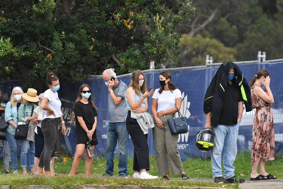 People line up for Covid-19 testing at Mona Vale Hospital's walk-in clinic in Sydney. Source: AAP