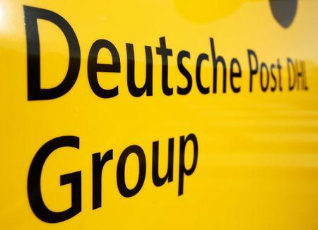 "The logo of German postal and logistics group Deutsche Post DHL is seen on the delivery car ""Street Scooter"" in Aachen, Germany, August 23, 2016.      REUTERS/Thilo Schmuelgen/File Photo"