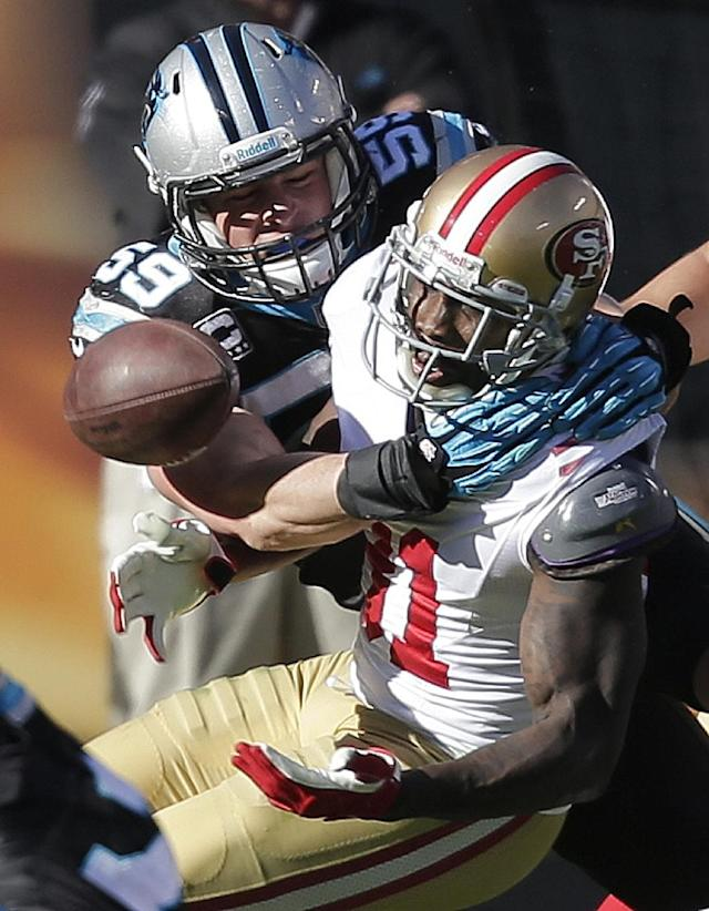 San Francisco 49ers wide receiver Anquan Boldin (81) misses a catch against Carolina Panthers middle linebacker Luke Kuechly (59) during the first half of a divisional playoff NFL football game, Sunday, Jan. 12, 2014, in Charlotte, N.C. (AP Photo/Chuck Burton)