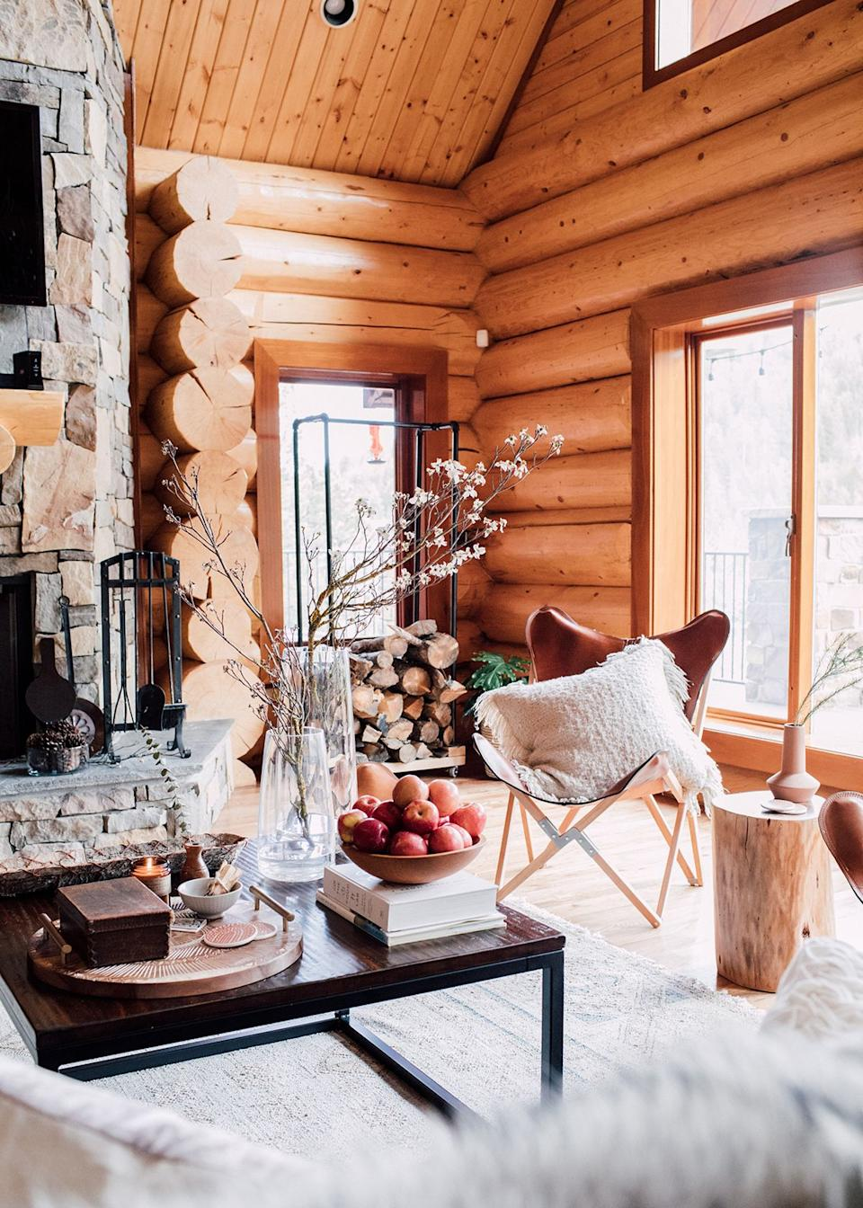 """Although the cabin's vaulted ceilings are the stuff of Pinterest dreams, furnishing the open-floor-plan living room came with a particular set of challenges, explains Kula. """"It requires that everything works together seamlessly, as opposed to a space that is more compartmentalized and designed room by room,"""" she elaborates. """"Although it's difficult, when you get it right, you create a space that feels so right. That's the real magic. It all feels so thoughtful and intentional; every detail is in its rightful, styled place."""""""