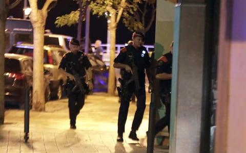 panish Policemen inspect a street in Cambrils  - Credit: Cambrils /EFE