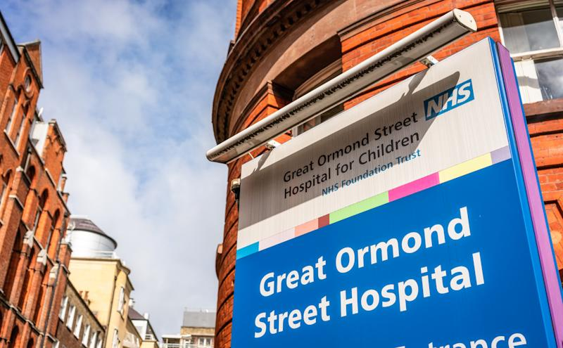 London, UK - A sign by the street entrance of the Sign for Great Ormond Street Hospital for Children, an NHS hospital in London.