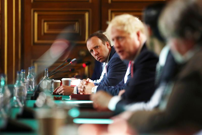 LONDON, ENGLAND - JULY 21: Health Secretary Matt Hancock looks on as Prime Minister Boris Johnson chairs a face-to-face meeting of his cabinet team of ministers, the first since mid-March, at the Foreign and Commonwealth Office (FCO) on July 21, 2020 in London, England. The meeting in the FCO will take place in a ventilated room in the Foreign Office large enough to allow ministers to sit at least one metre apart. (Photo by Simon Dawson - WPA Pool/Getty Images)