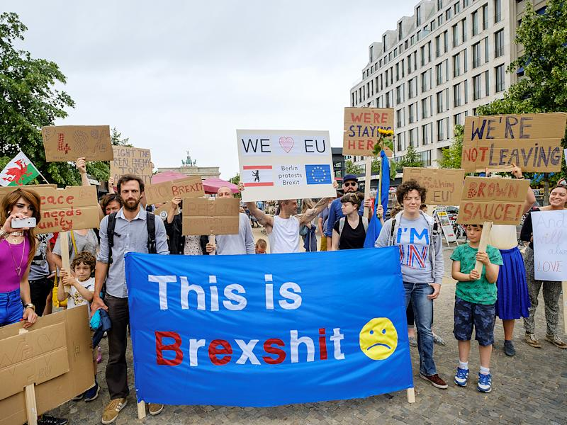 British expats hold up signs to protest for the United Kingdom to remain in the European Union: Getty Images