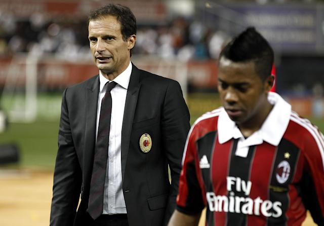 NEW YORK - AUGUST 08: Head coach Massimiliano Allegri leaves the field with Robinho #70 of A.C. Milan after loss against Real Madrid at Yankee Stadium on August 8, 2012 in New York City. (Photo by Jeff Zelevansky/Getty Images)