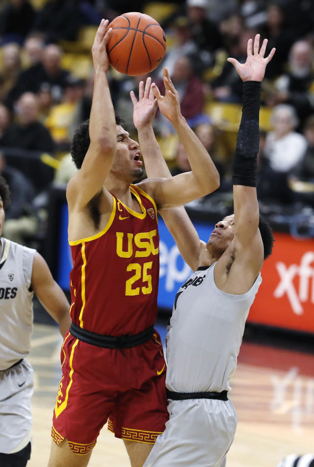 Southern California forward Bennie Boatwright, left, goes up for a basket as Colorado guard Tyler Bey defends in the first half of an NCAA college basketball game Saturday, March 9, 2019, in Boulder, Colo. (AP Photo/David Zalubowski)