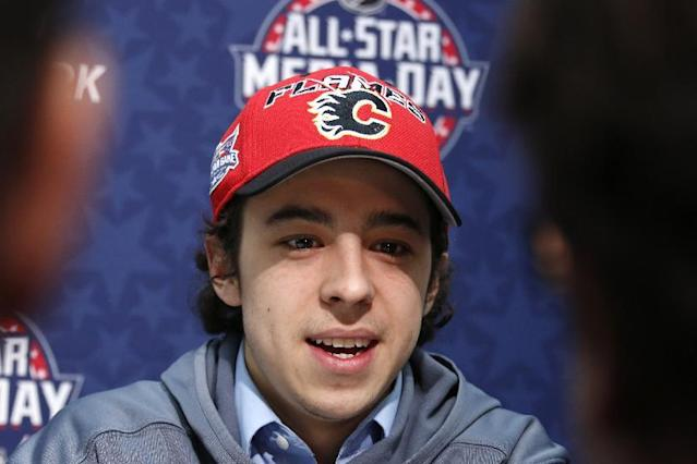 Calgary Flames' Johnny Gaudreau is interviewed during media day at the NHL All-Star hockey weekend in Columbus, Ohio, Friday, Jan. 23, 2015. (AP Photo/Gene J. Puskar