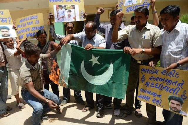 Indian activists burn a Pakistani national flag during a protest for the late Sarabjit Singh in Ahmedabad on May 2, 2013. An Indian man on death row in Pakistan for spying died nearly a week after he was attacked by fellow prisoners, who were swiftly charged with murder as New Delhi demanded justice. Sarabjit Singh, who was sentenced 16 years ago over deadly bombings, died in the early hours as a result of the savage assault in Lahore's Kot Lakhpat jail, a senior doctor at Jinnah hospital in the eastern city told AFP. AFP PHOTO / Sam PANTHAKY (Photo credit should read SAM PANTHAKY/AFP/Getty Images)