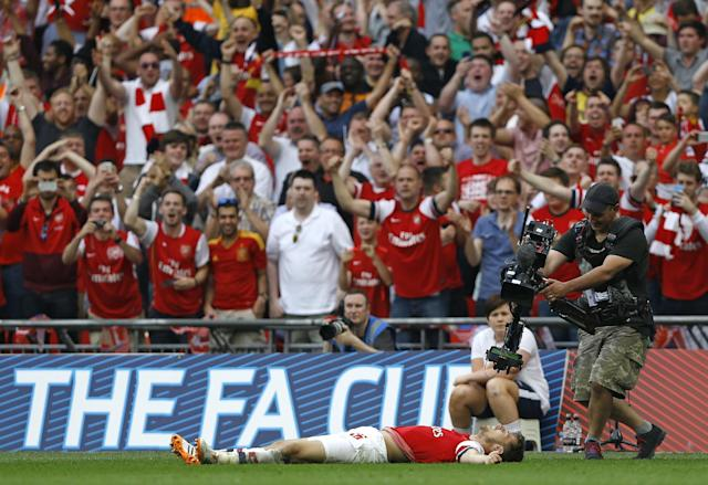 Arsenal's Aaron Ramsey celebrates after scoring his sides 3rd goal during the English FA Cup final soccer match between Arsenal and Hull City at Wembley Stadium in London, Saturday, May 17, 2014. (AP Photo/Kirsty Wigglesworth)