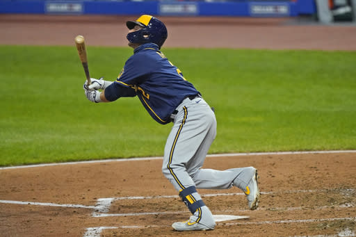 Milwaukee Brewers' Luis Urias watches his RBI-single in the fourth inning in a baseball game against the Cleveland Indians, Friday, Sept. 4, 2020, in Cleveland. (AP Photo/Tony Dejak)