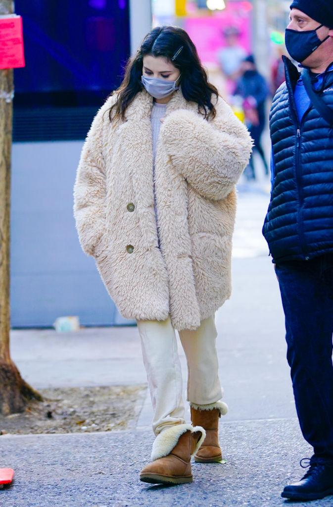 Selena Gomez wearing her Bailey Button II Boot Uggs and Free People jacket in NYC. (Photo by Gotham/GC Images)