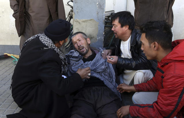 <p>A distraught man is cared for outside a hospital following a suicide attack in Kabul, Afghanistan, Thursday, Dec. 28, 2017. (Photo: Rahmat Gul/AP) </p>