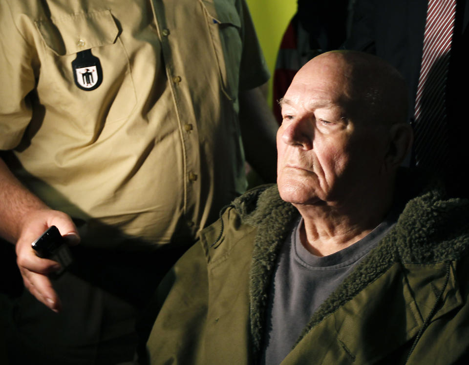 John Demjanjuk leaves the court room in Munich, southern Germany, Thursday, May 12, 2011. The court has ordered John Demjanjuk released pending an appeal of his conviction as an accessory to murder at a Nazi death camp. (AP Photo/Matthias Schrader)