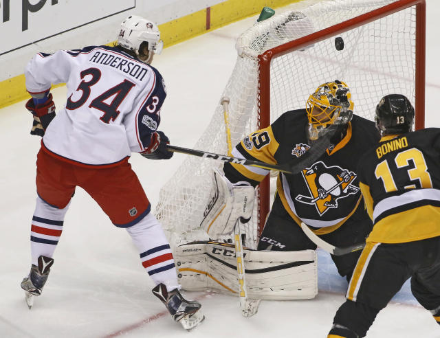 Columbus Blue Jackets' Josh Anderson (34) can't get a shot to go in over Pittsburgh Penguins goalie Marc-Andre Fleury (29) during the first period in Game 5 of an NHL first-round hockey playoff series in Pittsburgh, Thursday, April 20, 2017. (AP Photo/Gene J. Puskar)