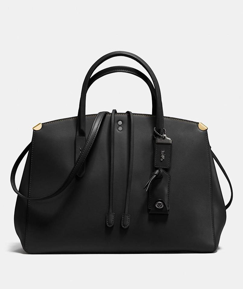 """<p>Whether you're looking to upgrade your work bag or need a stylish carryall for weekend errands, the Cooper is one of our top picks. What we love most is its convertibility—it includes a detachable strap that you can use to carry the bag crossbody-style or over your shoulder, but it looks great as handbag, too! The interior is lined with a lovely suede, and you'll also find a handy inside zippered pocket that helps keep everything in one place. </p> <p><strong>To buy:</strong> $298 (was $597); <a href=""""https://click.linksynergy.com/deeplink?id=93xLBvPhAeE&mid=37299&murl=http%3A%2F%2Fwww.coach.com%2Fcoach-cooper-carryall%2F22821.html&u1=RS%2C7BagsWe%25E2%2580%2599reObsessedWithFromCoach%25E2%2580%2599sInsane50%2525OffCyberMondaySale%2Cmalcedo805%2CHAN%2CIMA%2C657689%2C201912%2CI"""" target=""""_blank"""">coach.com</a>.</p>"""